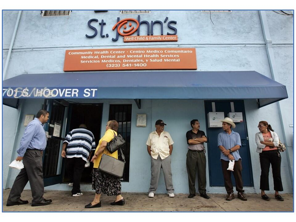 Individuals waiting outside of a community health center